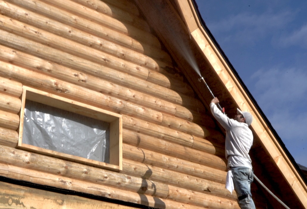 Roof cleaning a log home in Olympia